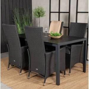 میز ناهار خوری با صندلی های حصیری شکل