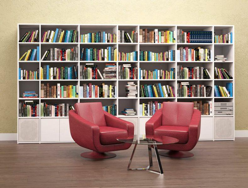 کتابخانه با قفسه سفید و صندلی قرمز