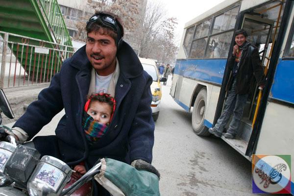 جامعه عکس یک موتور سوار با کودک