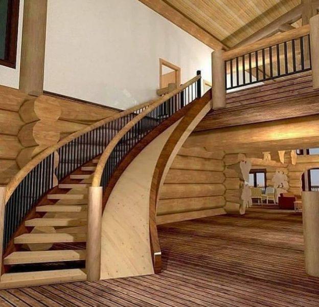 ساخت پله قوس و سرسره چوبی در یک ویلای چوبی ساخته شده با تنه درخت